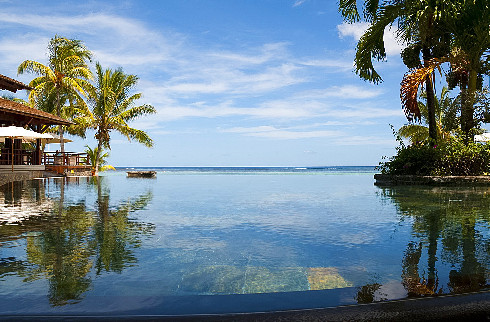 An infinity pool facing the sea at the Lux Le Morne Hotel on Le Morne Brabant Peninsula in south west Mauritius, Indian Ocean, Africa - 149-6621