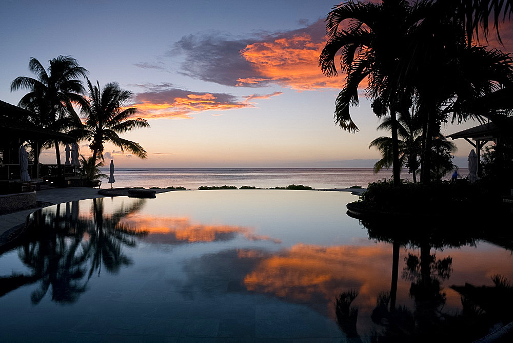 Sunset over an infinity pool at the Lux Le Morne Hotel on Le Morne Brabant Peninsula in south west Mauritius, Indian Ocean, Africa - 149-6622