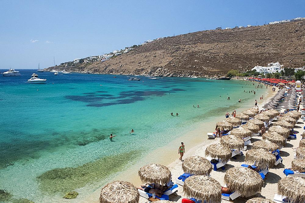 Thatched umbrellas on Ornos Beach on Mykonos, The Cyclades, Greek Islands, Greece, Europe