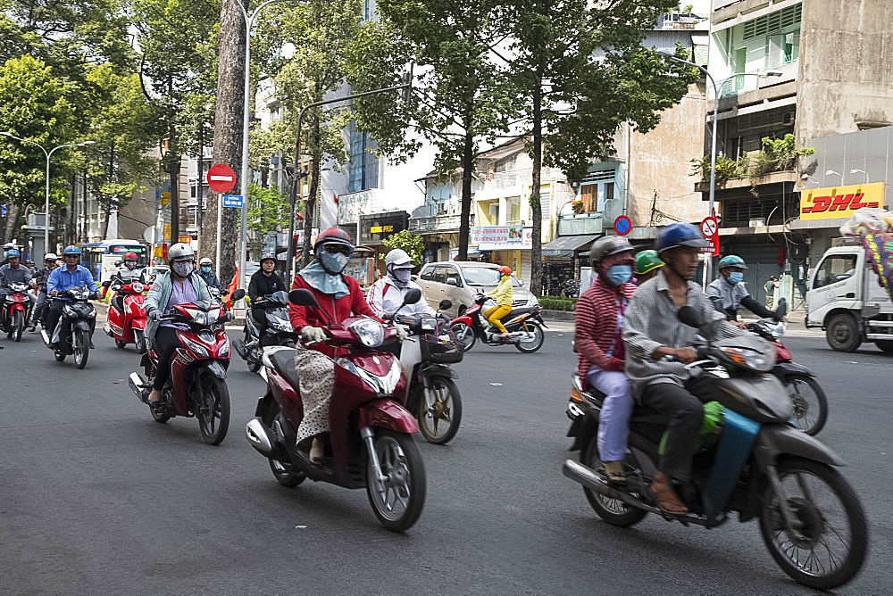 Motorcyclists on a busy street in Ho Chi MInh City, Vietnam, Indochina, Southeast Asia, Asia