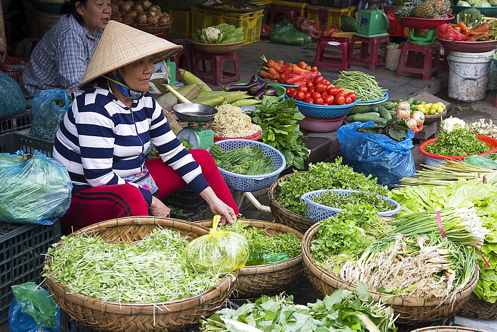 A woman selling vegetables at the market in Hoi An, Quang Nam Province, Vietnam, Indochina, Southeast Asia, Asia