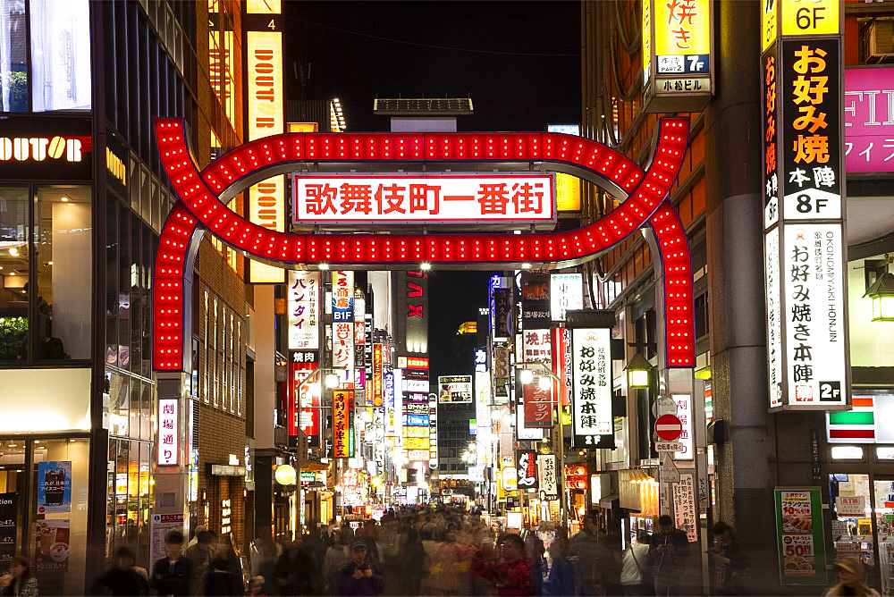 A neon red gate (torii) and neon signs in the Kabukicho district, centre of nightlife and entertainment in Tokyo, Honshu, Japan, Asia