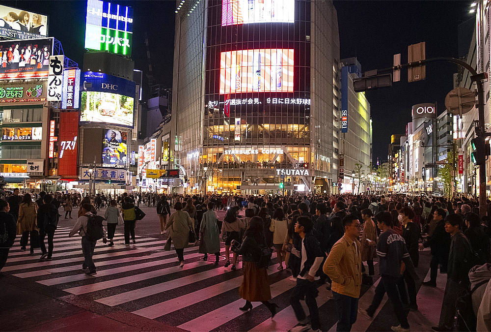 Neon signs above crowds at the Shibuya Crossing in Tokyo, Japan, Asia