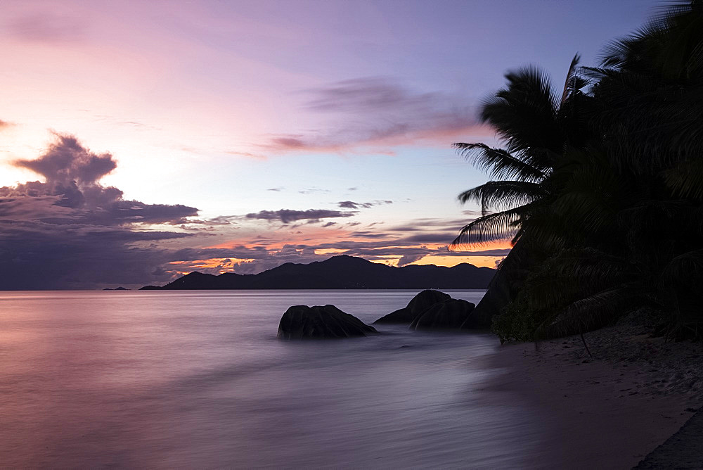 Sunset at Anse Source d'Argent looking toward Praslin, Union Estate Park, La Digue, Seychelles, Indian Ocean, Africa