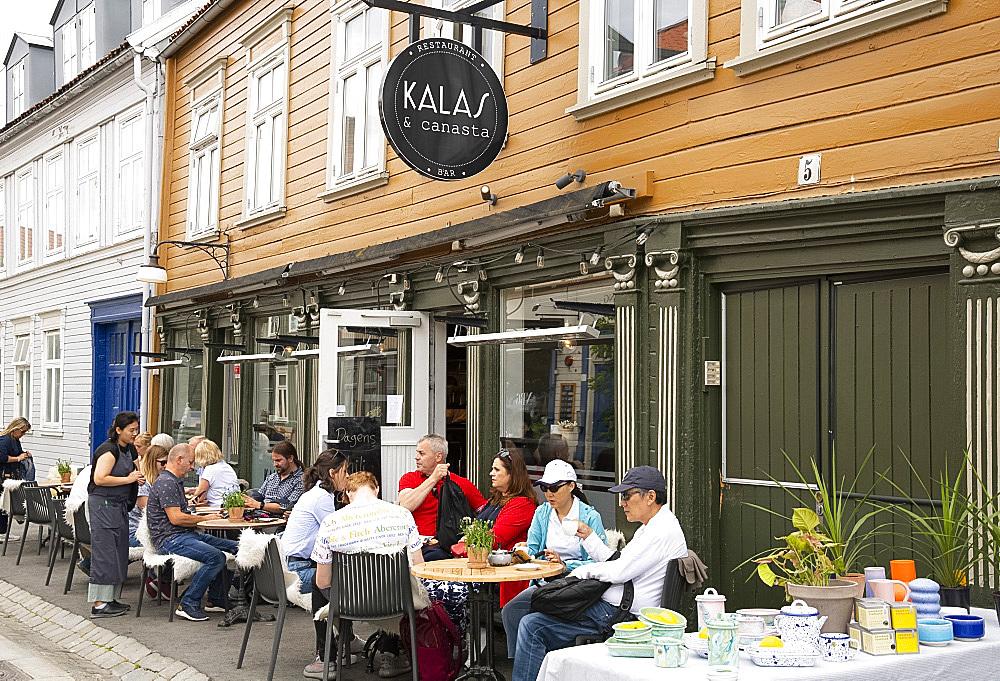 An outdoor cafe in the Mollenberg district of Trondheim, Trondelag, Norway, Scandinavia, Europe