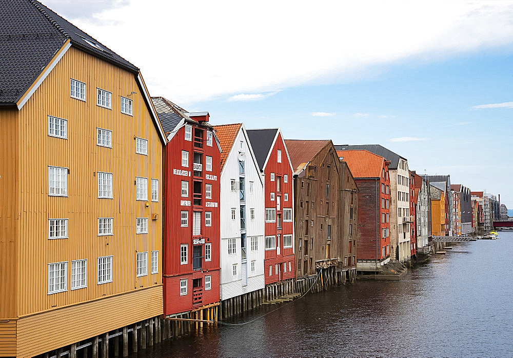 Old wooden warehouses on the Nidelva River in Trondheim, Trondelag, Norway, Scandinavia, Europe