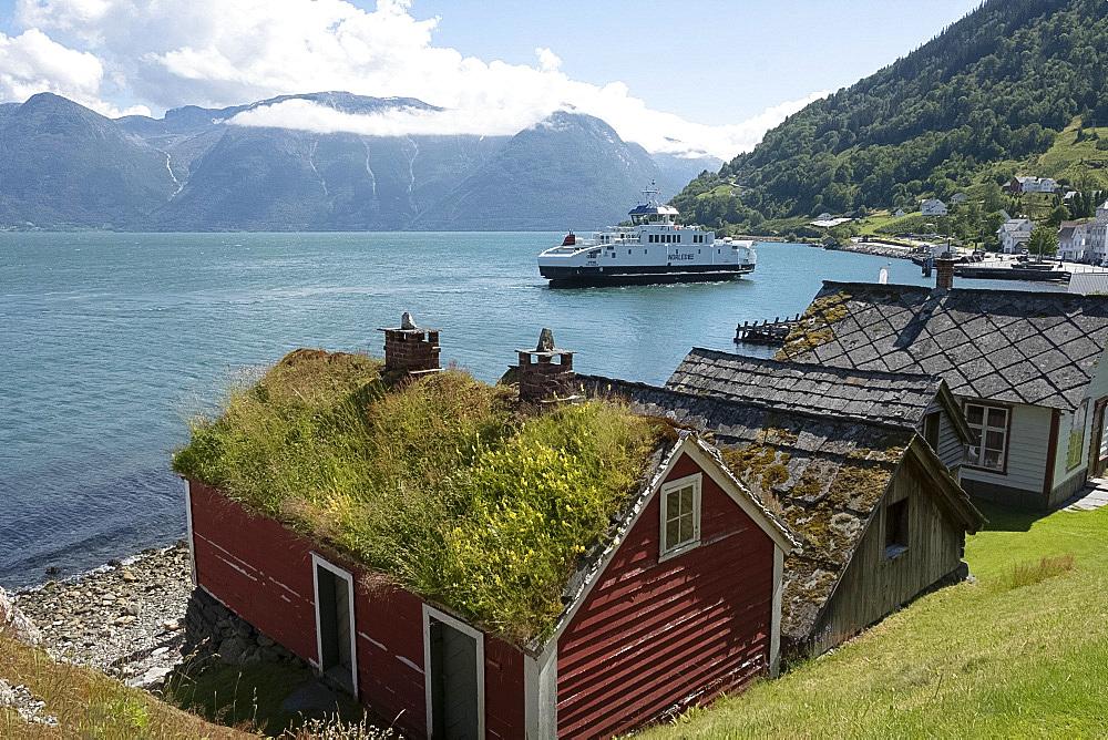 A ferry leaving the village of Utne on Hardanger Fjord, Vestlandet, Norway, Scandinavia, Europe
