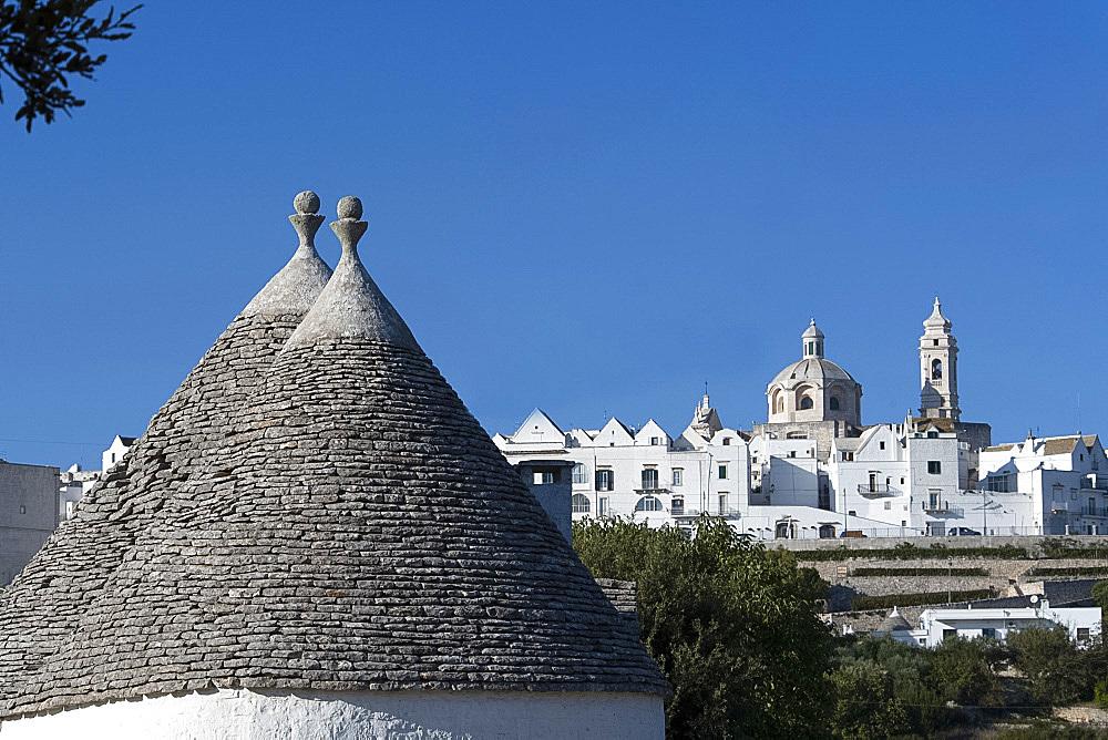 Cone shaped roofs of Trulli outside the historic center of Locorotondo, Valle d'Itria, Bari district, Puglia, Italy, Europe