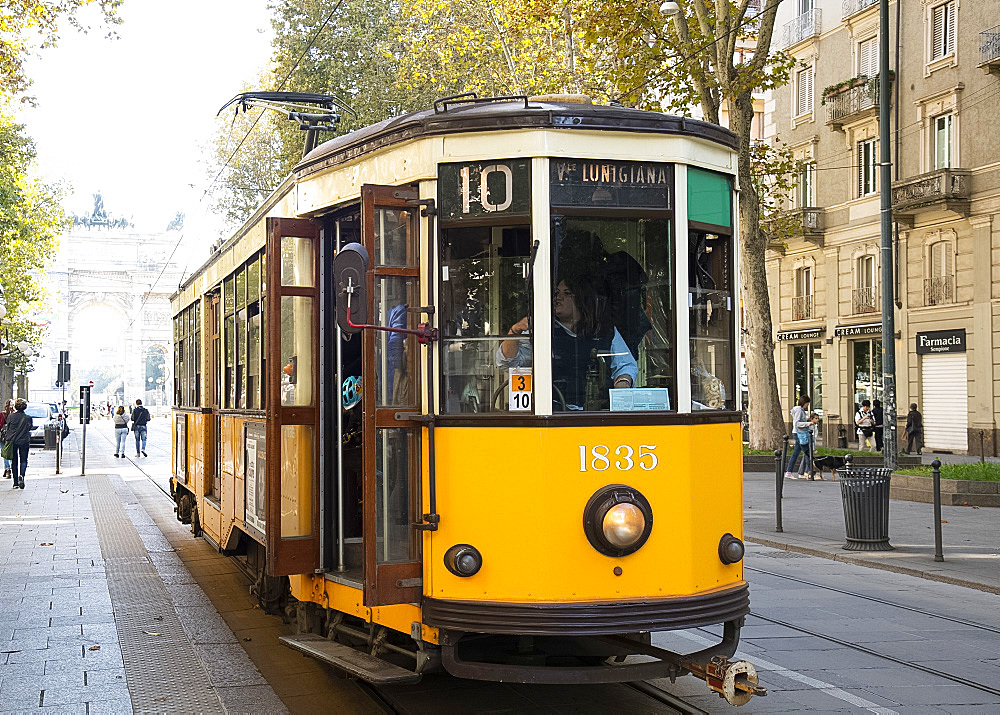 A 1920s yellow electric tram in central Milan, Lombardy, Italy, Europe