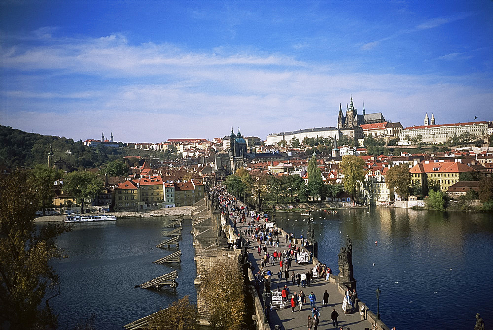Charles Bridge over the River Vltava and city skyline, Prague, Czech Republic, Europe