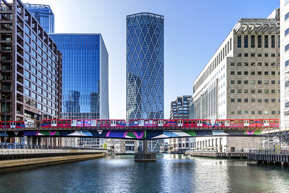 Dockland Light Railway (DLR) train crossing Middle Dock at Canary Wharf, Docklands, London, England, United Kingdom, Europe - 190-9841