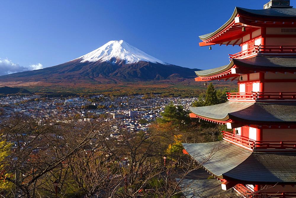 Mount Fuji capped in snow and the upper levels of a temple, Fuji-Hakone-Izu National Park, Chubu, Central Honshu, Japan, Asia