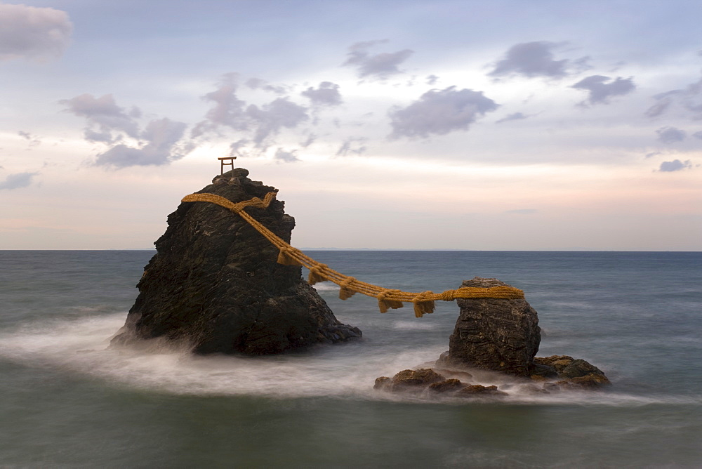 Meoto-Iwa (Wedded Rocks), two rocks considered to be male and female and joined in matrimony by shimenawa (sacred ropes), renewed in a special festival each year, Futami, Ise-Shima, Chubu, Central Honshu, Japan, Asia