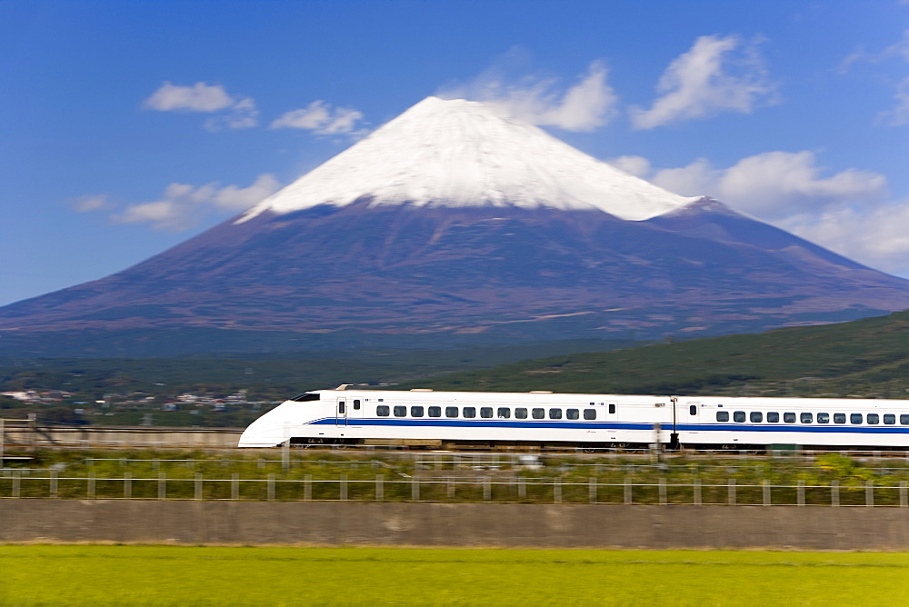 Shinkansen (Bullet train) which reaches speeds of up to 300km per hour passing Mount Fuji, blurred motion, Honshu, Japan, Asia - 252-11324