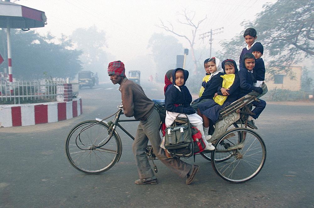 School children riding in a rickshaw in Agra, Uttar Pradesh state, India, Asia
