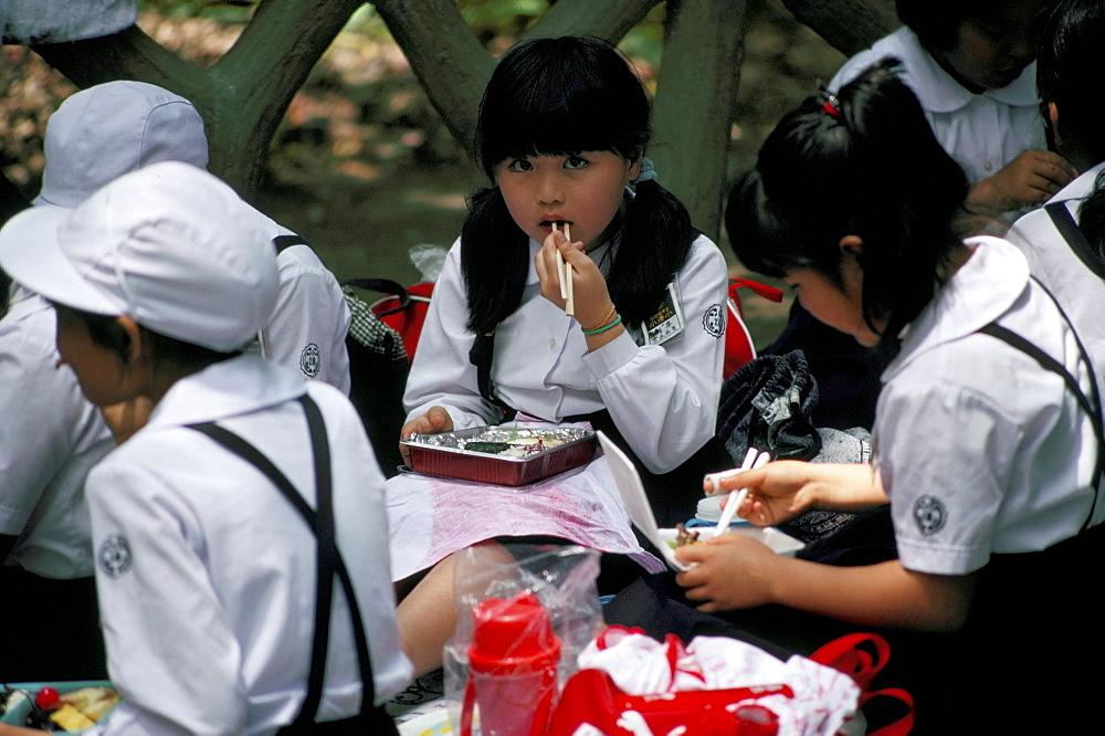 Schoolgirls eating packed lunch, Bento, Kagoshima Park, Japan, Asia