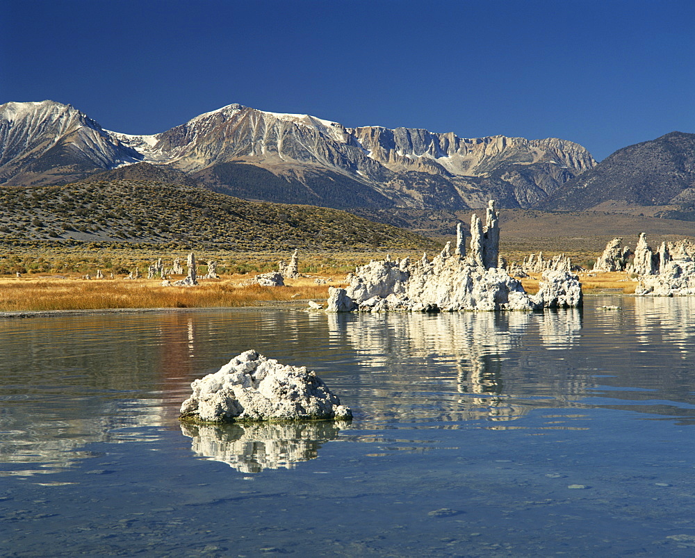 Tufas of calcium carbonate at lake in Mono Lake Tufa State Reserve, with mountains in the background, in California, United States of America, North America
