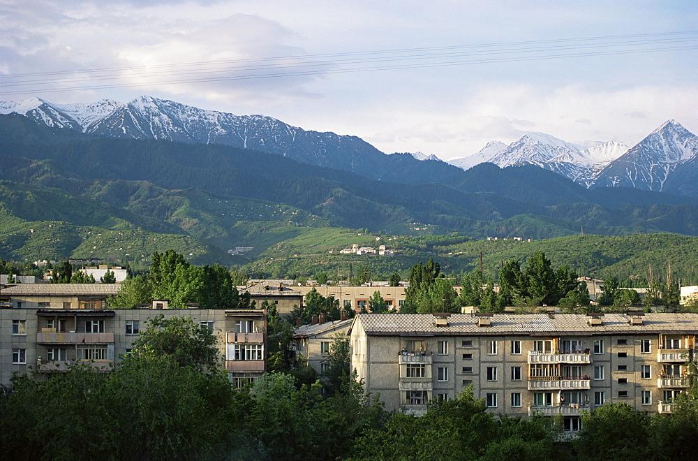 City apartments, Alma Ata, and Kungey-Ala-Too mountains, Kazakstan, Central Asia, Asia