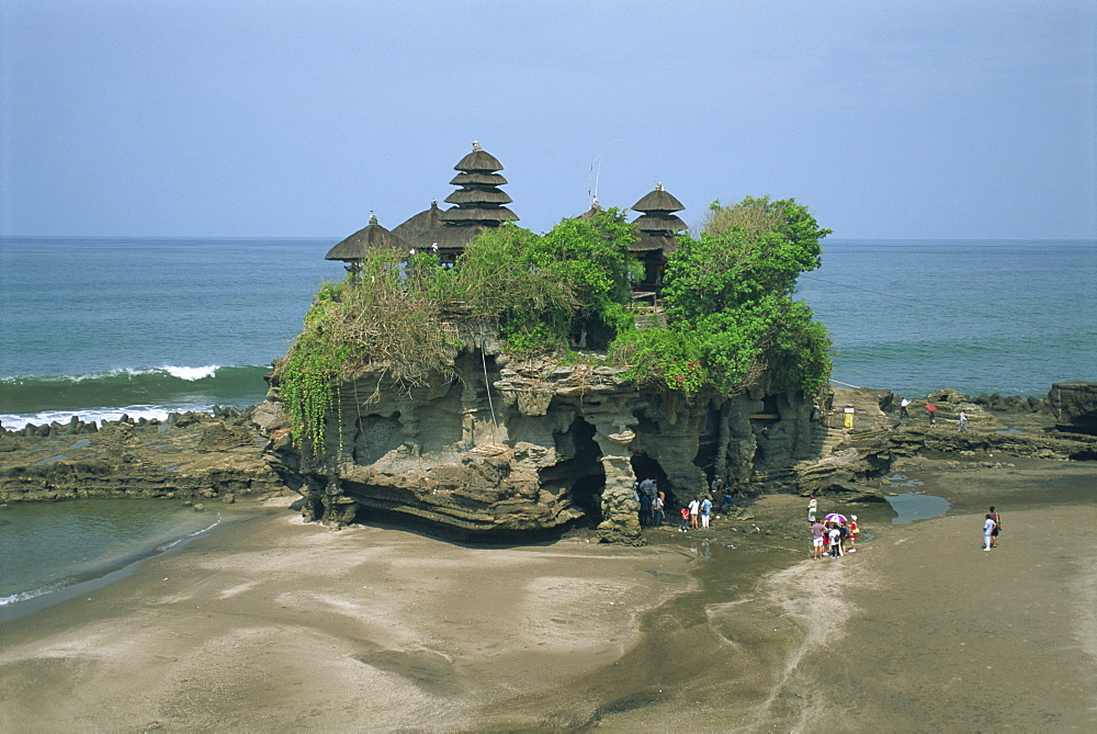 A group of tourists visit the Tanalot Temple on the island of Bali, Indonesia, Southeast Asia, Asia