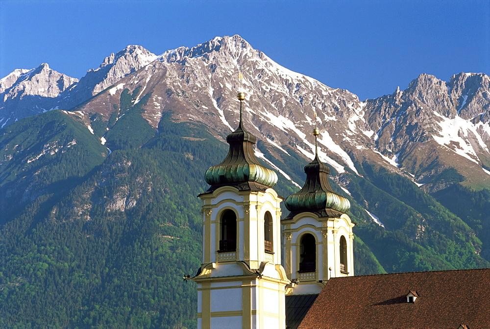 Church with mountain backdrop, Innsbruck, Tirol (Tyrol), Austria, Europe