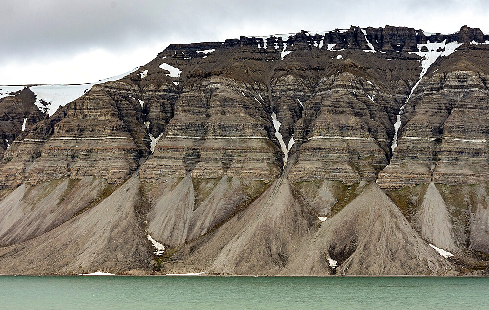 Large alluvial fans along wall of Tempelfjorden, Spitsbergen, Svalbard, Norway