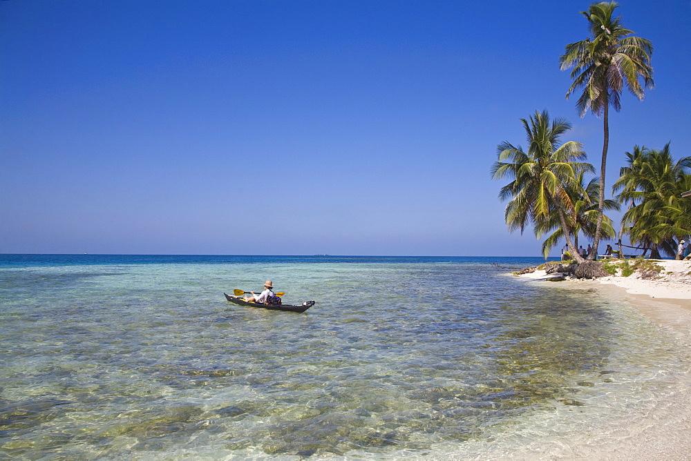 Tourist in sea cayak, Silk Caye, Belize, Central America