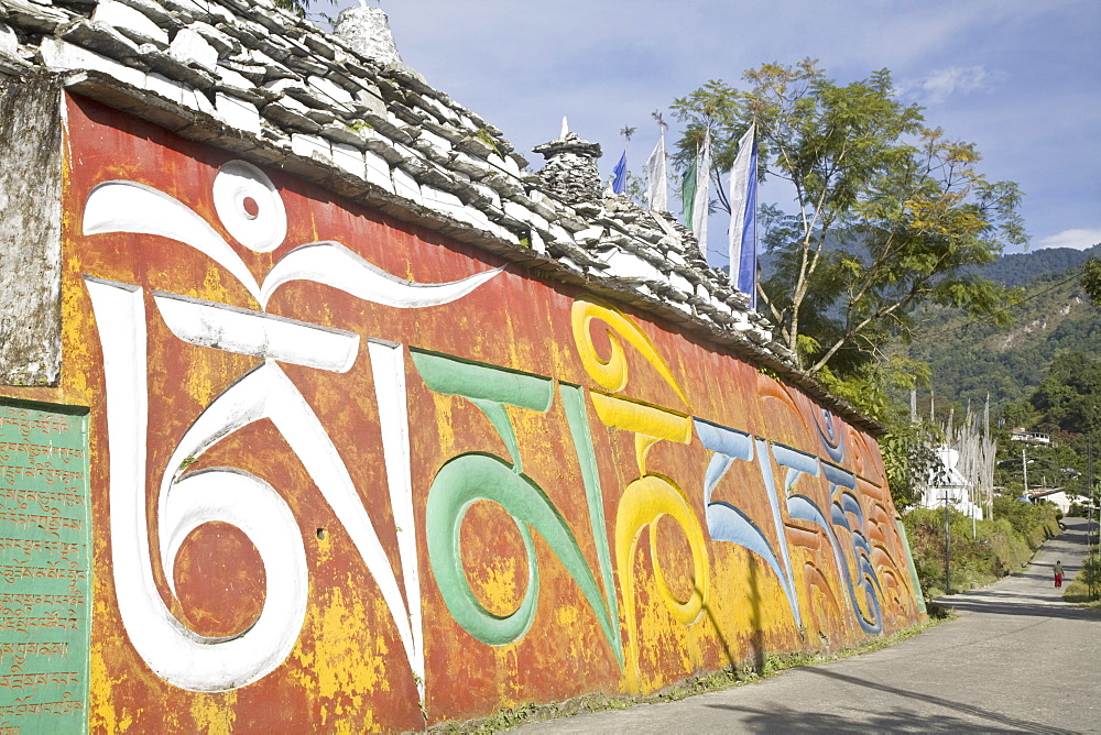 Colourful mani wall with Tibetan inscriptions, Tashiding, Sikkim, India, Asia
