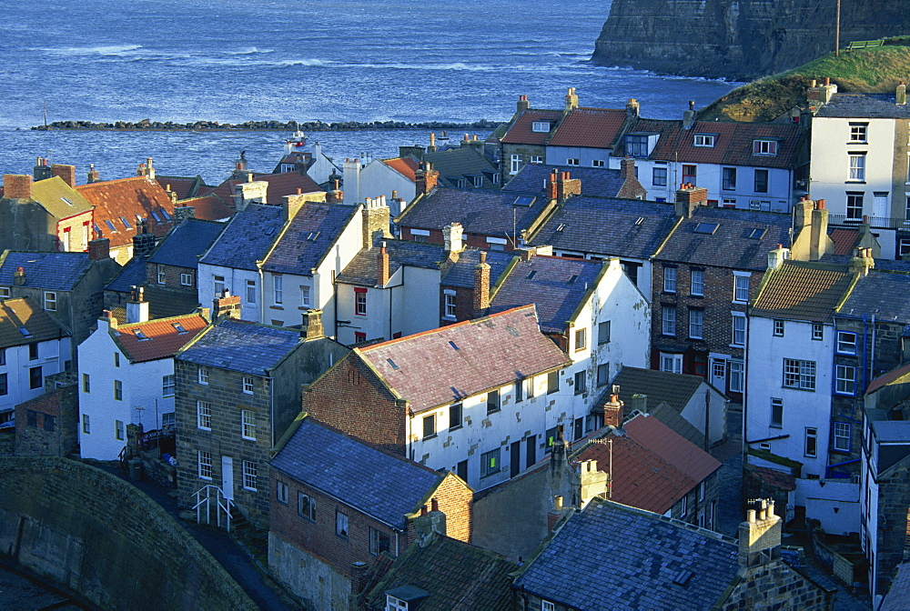 View over rooftops of the fishing village of Staithes, North Yorkshire coast, England, United Kingdom, Europe