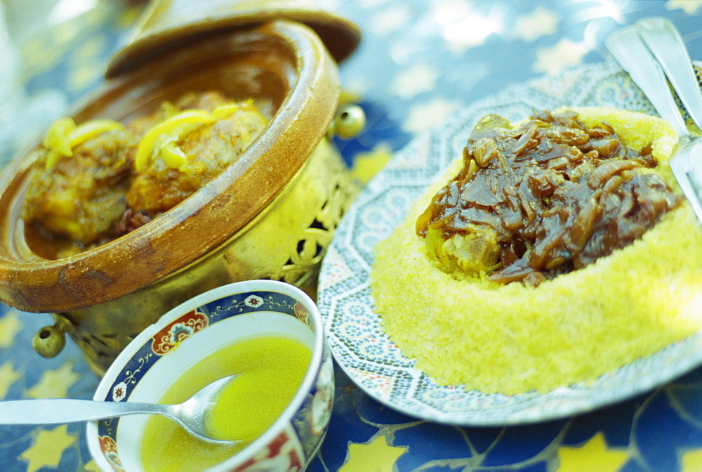 Traditional food of chicken tagine, and lamb with cous cous, Marrakech, Morocco, North Africa, Africa - 321-3284