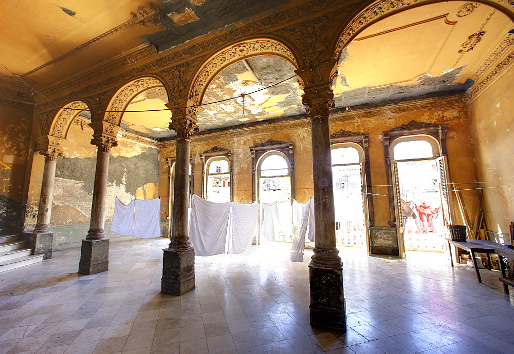 Interior of a once ornate and grand apartment building, now in a state of disrepair, Havana, Cuba, West Indies, Central America