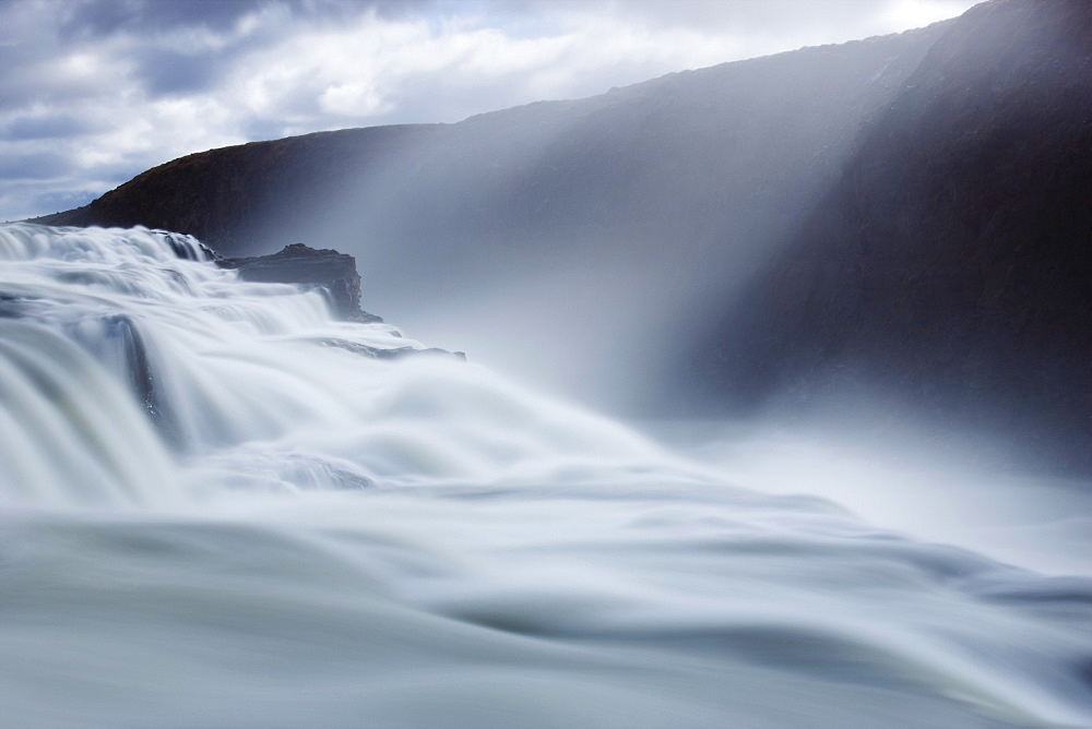 Thundering water at Gullfoss, Iceland's most famous waterfall, with sunlight streaming down through the spray, near Reykjavik, Iceland, Polar Regions