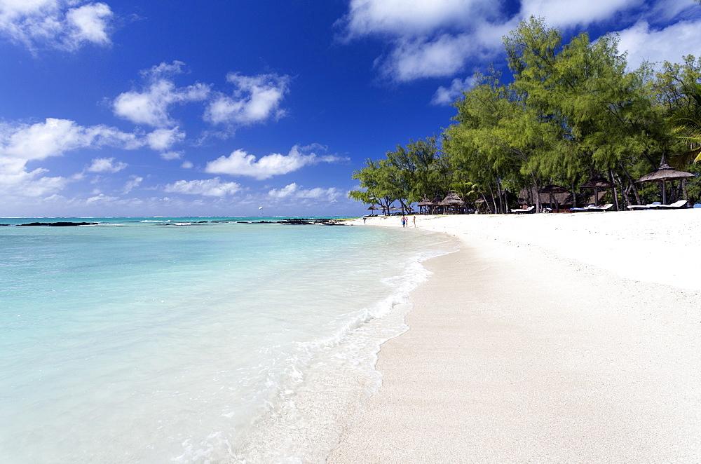 Idyllic beach scene with blue sky, aquamarine sea and soft sand, Ile Aux Cerfs, Mauritius, Indian Ocean, Africa