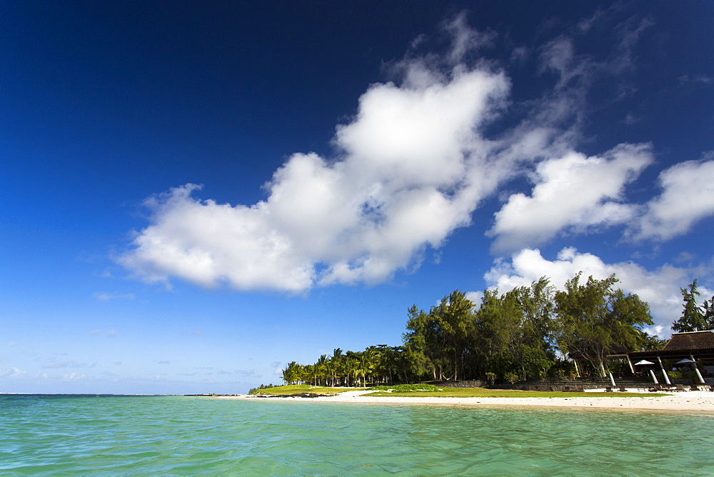 View of idyllic Belle Mare Beach showing blue sky, soft sand and the aquamarine sea of the Indian Ocean, near Centre De Flacq on the east coast of Mauritius, Indian Ocean, Africa