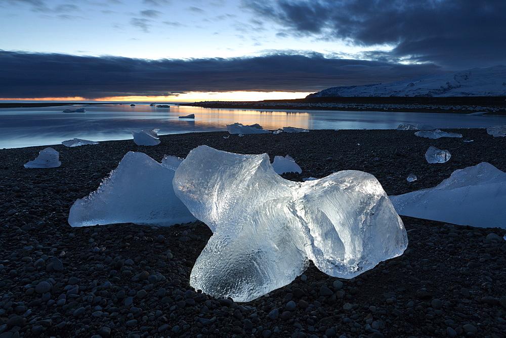 Icebergs at sunset on Jokulsa Beach, on the edge of the Vatnajokull National Park, South Iceland, Iceland, Polar Regions