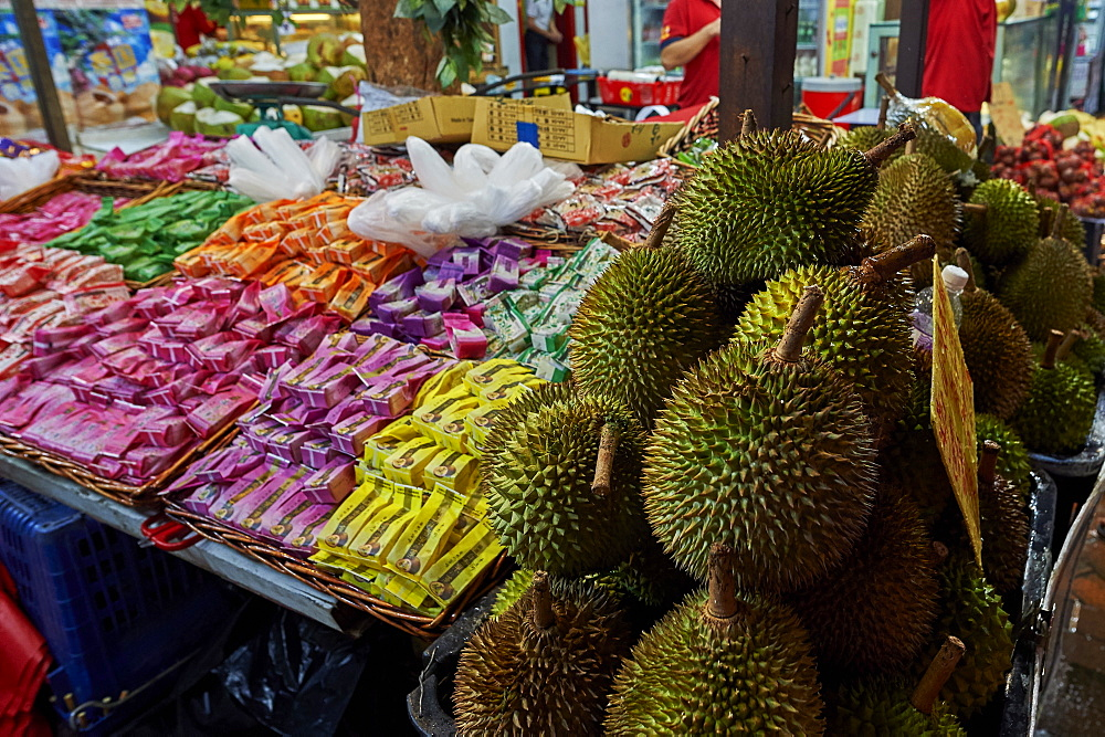 Durian fruit for sale in Chinatown. The fruit's odour when cut means it is banned from public transport and some public building - 358-593