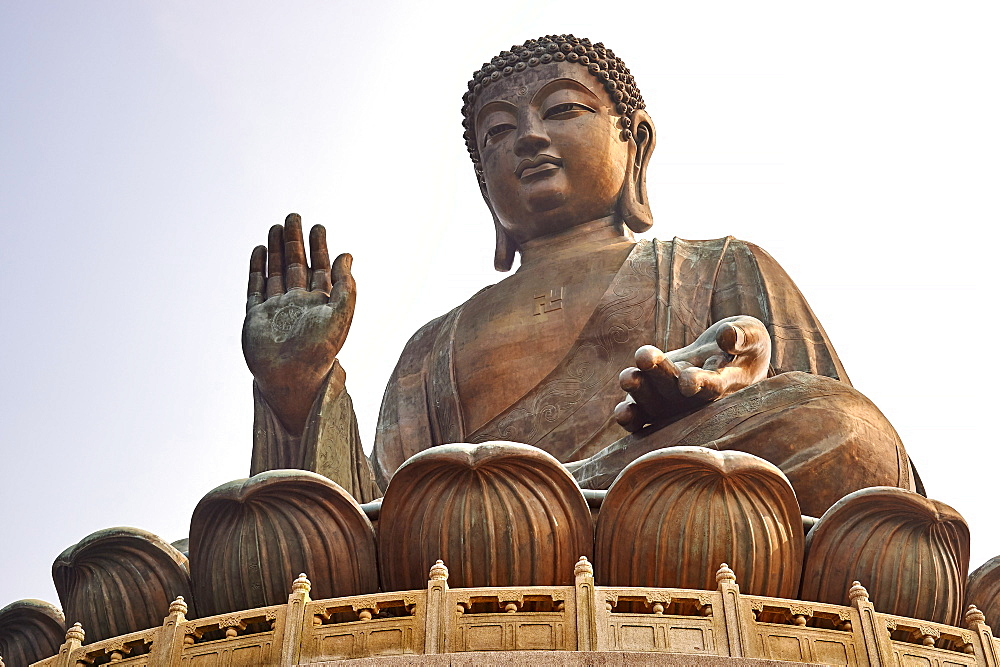 Big Buddha, showing the Buddhist swastika, Po Lin Monastery, Ngong Ping, Lantau Island, Hong Kong, China, Asia.
