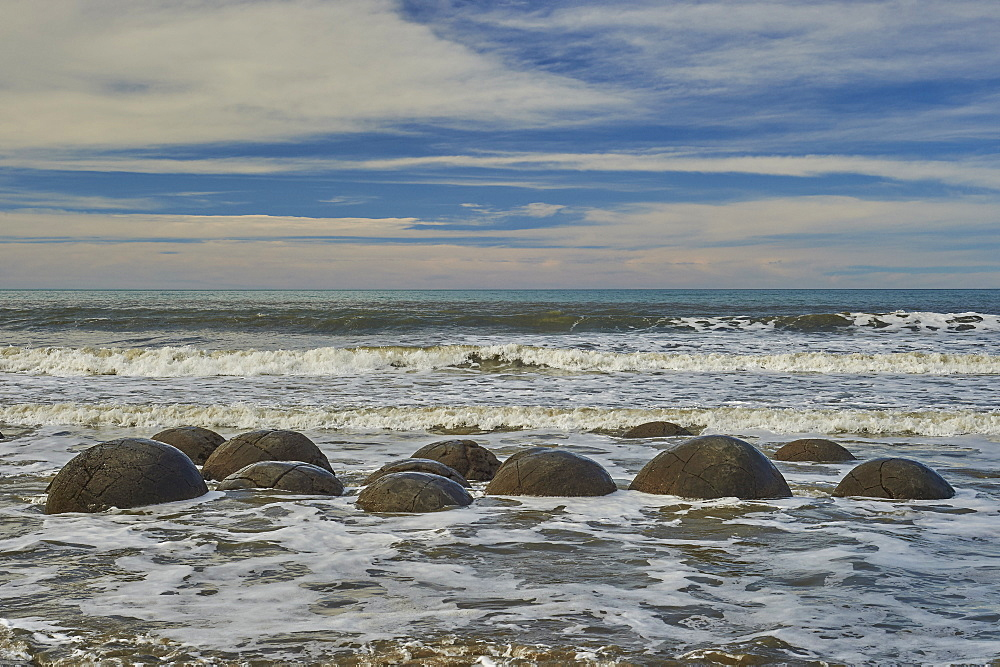 Moeraki Boulders, a group of very large spherical boulders on Koekohe Beach near Moeraki on the coast of Otago, South Island, New Zealand, Pacific