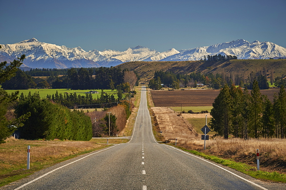 Open road on State Highway 6 near Cromwell, Central Otago with views to the ski fields at Wanaka, Otago, South Island, New Zealand, Pacific - 358-682