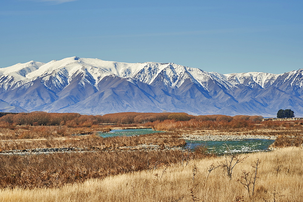 View to Southern Alps over a mountain stream near Twizel, Central Otago, South Island, New Zealand, Pacific - 358-686