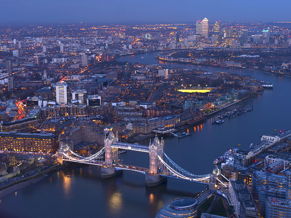 Aerial photo showing Tower Bridge, River Thames and Canary Wharf at dusk, London, England, United Kingdom, Europe - 367-5961