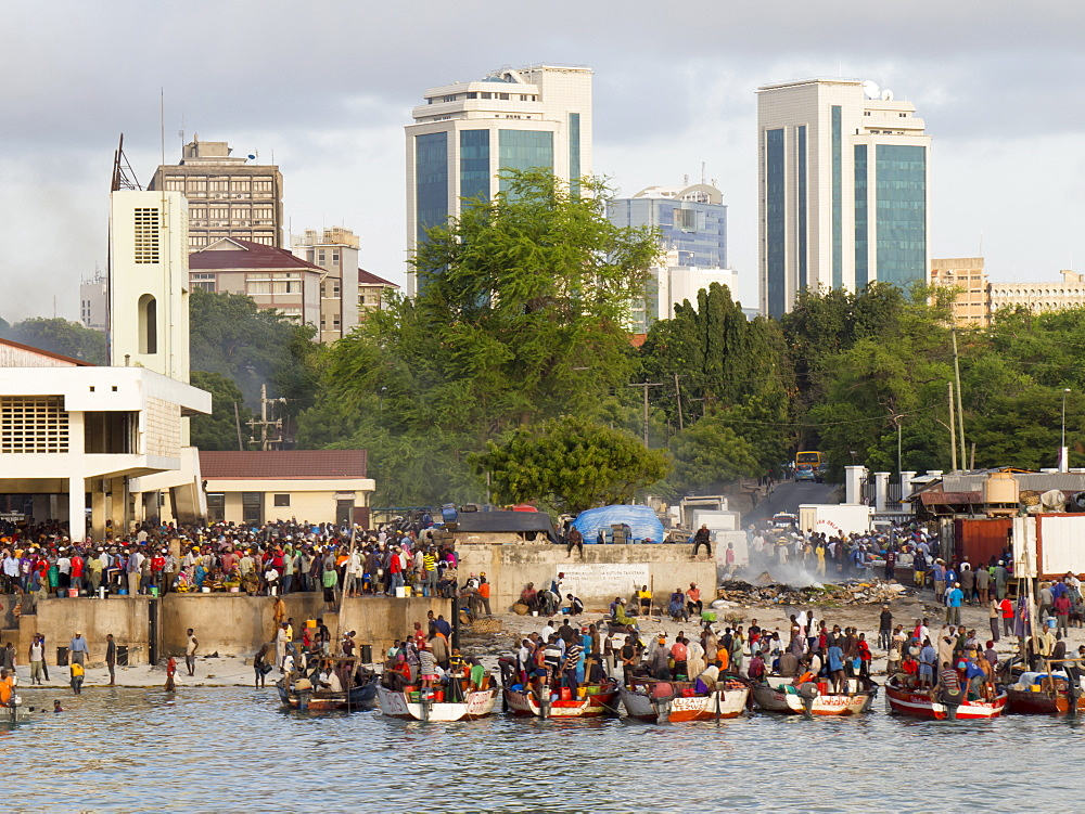 Fishing market with modern city behind, Dar es Salaam, Tanzania, East Africa, Africa