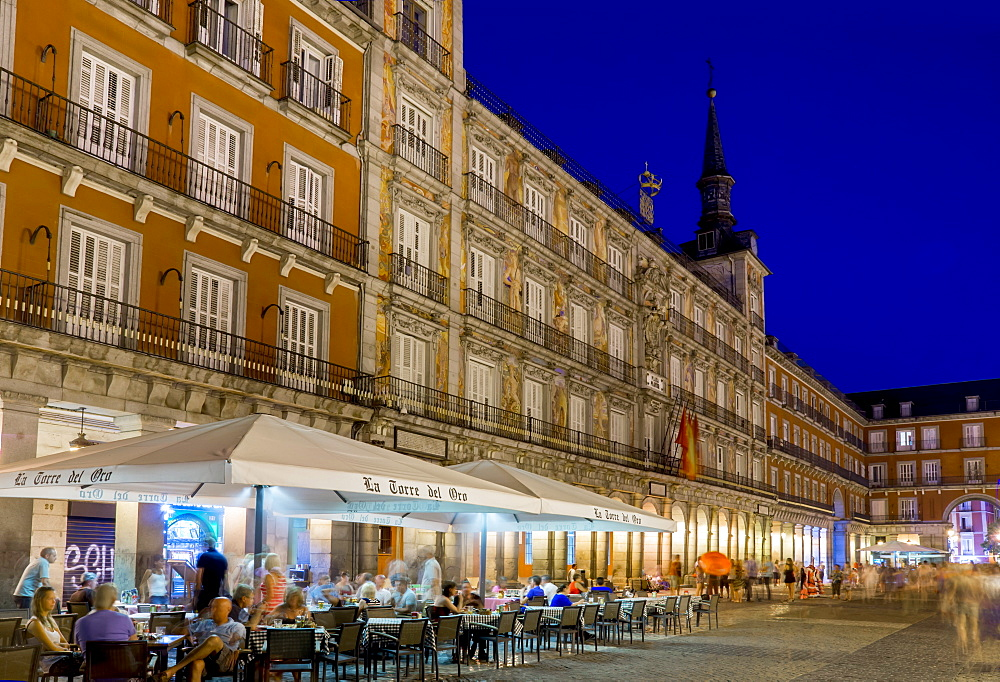 Plaza Mayor cafes at dusk, Madrid, Spain, Europe