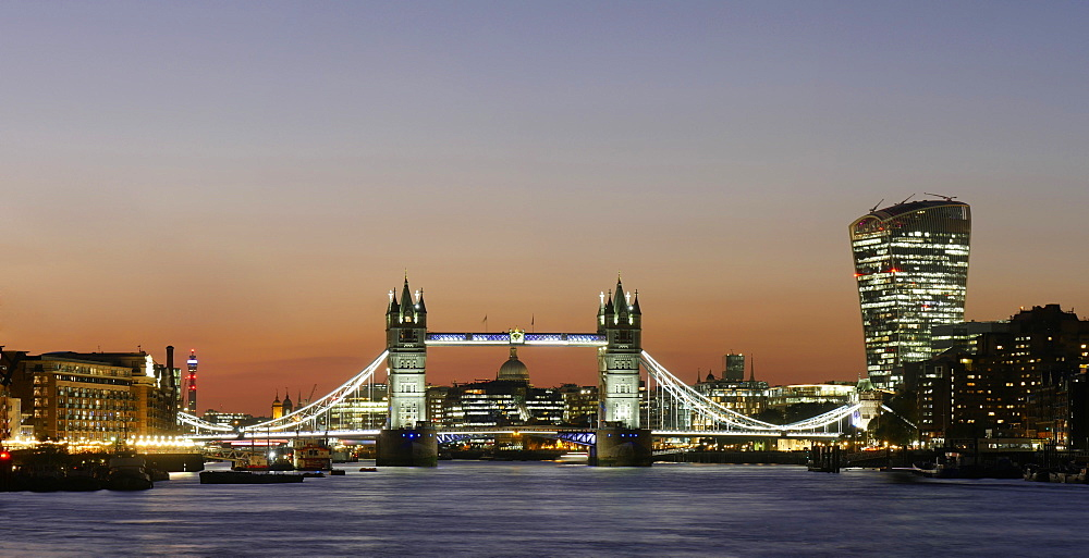 Panoramic view of Tower Bridge framing St. Paul's Cathedral with the City tower blocks at dusk, London, England, United Kingdom, Europe