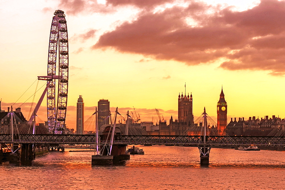 Skyline of London at dusk, with London Eye (Millennium Wheel), Big Ben and Houses of Parliament, London, England, United Kingdom, Europe