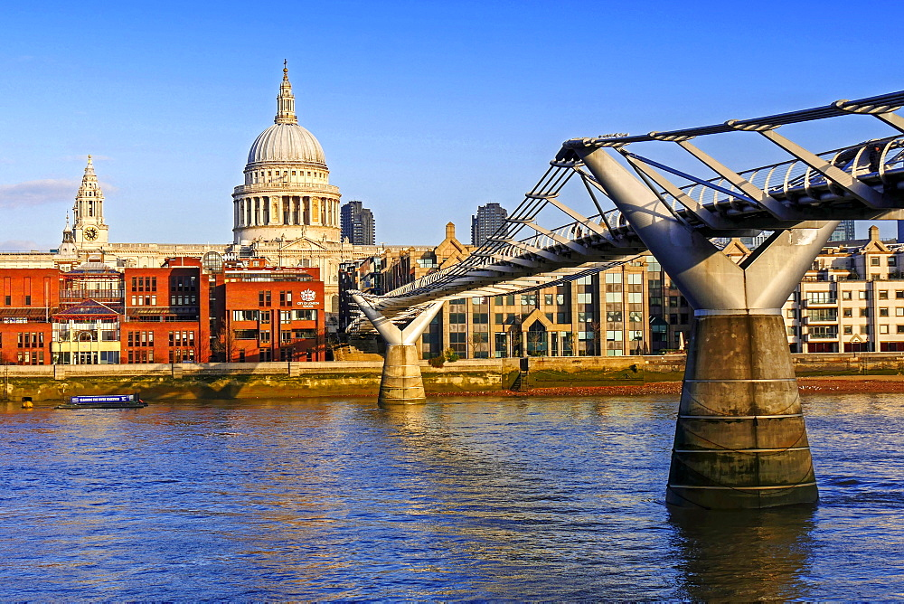 Millenium Bridge, Thames River and St. Pauls Cathedral, London, United Kingdom