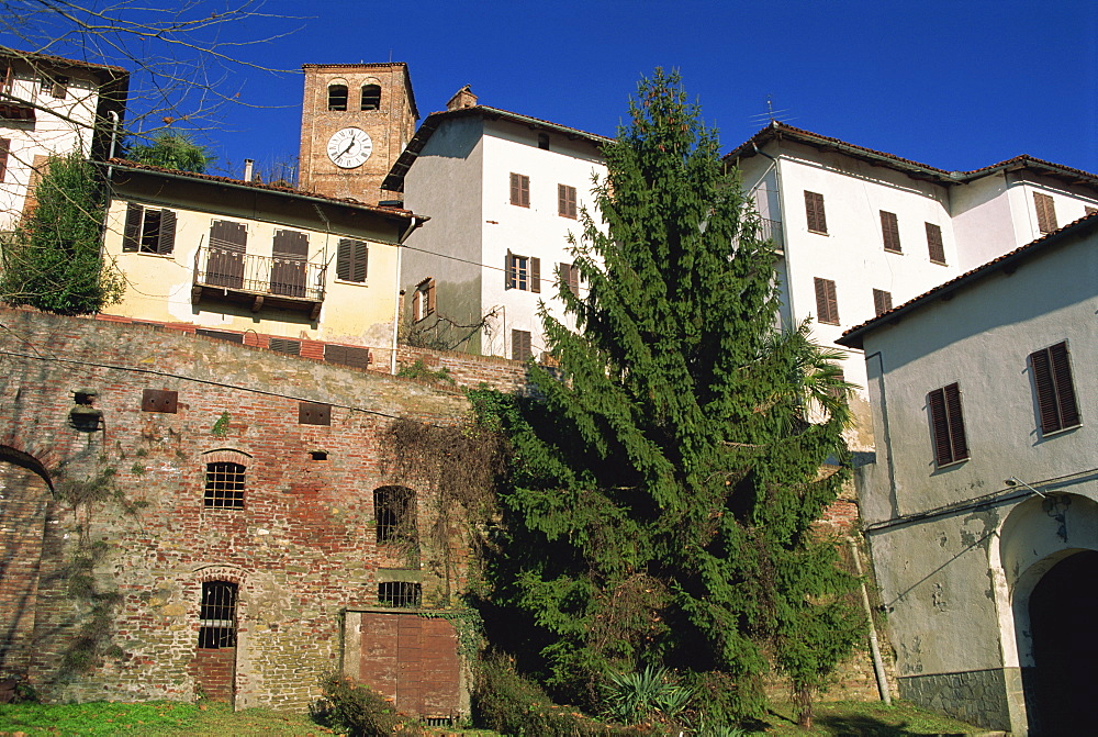 Houses and clocktower in the medieval quarter of the town of Casalborgone near Turin in Piemonte, Italy, Europe
