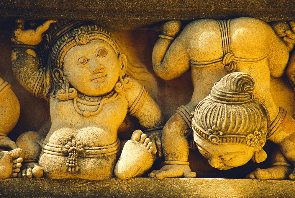 Dwarf carvings line temple wall, Kelaniya Temple, near Colombo, Sri Lanka, Asia - 450-2957