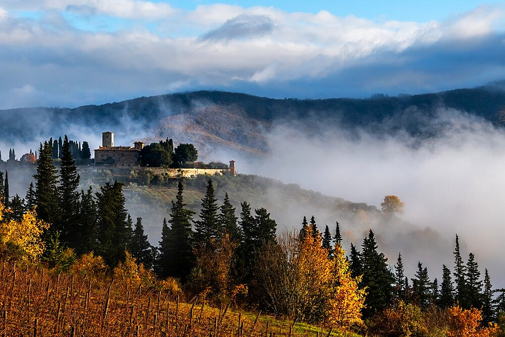 Castello di Colognole as sun breaks through early morning mist, Greve in Chianti, Tuscany, Italy - 450-4452