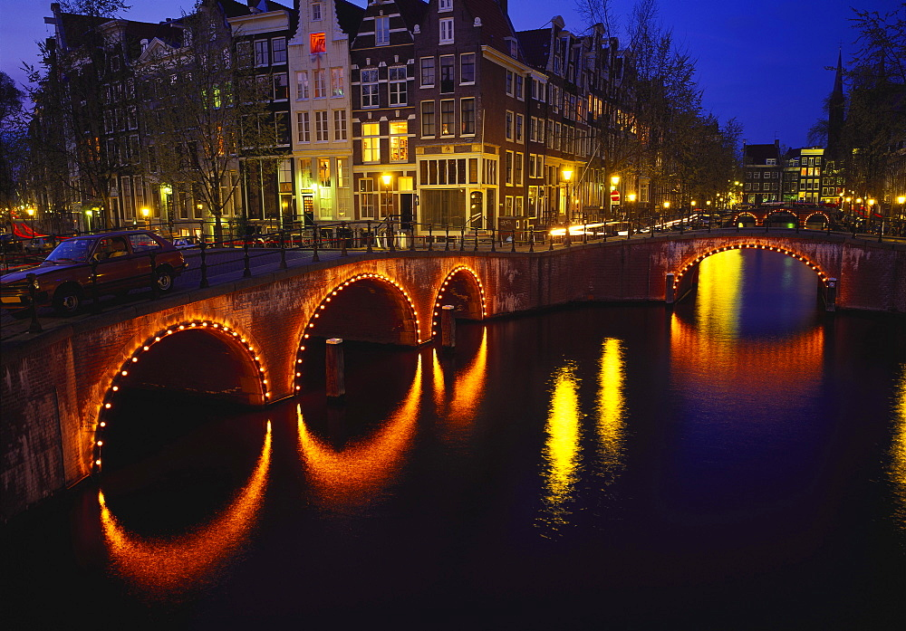 Illuminated Bridges Reflected in the Canals at Night, Keizersgracht, Amsterdam, Netherlands
