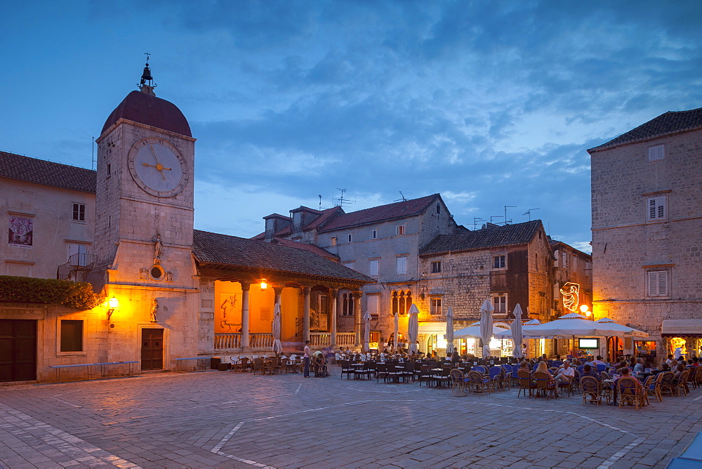 Main square lit up at dusk with cafes, Trogir, UNESCO World Heritage Site, Dalmatian Coast, Croatia, Europe  - 526-3784